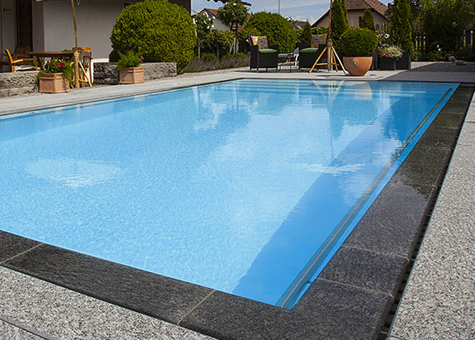 Piscine d bordement piscine miroir construction de for Installation piscine miroir